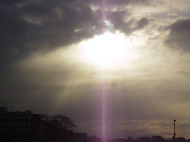 雲にかかった夕陽