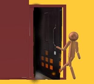 ドアが少し開いたところに足を入れている人物